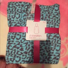Turquoise, leopard sleeping tunic NWT. Still wrapped in it's pink ribbon. Small, turquoise, leopard long sleeve. Long length with hood. Very soft material. Perfect for wearing during cold nights.   Feel free to ask me any questions. Thanks for checking my items out <3 Xhilaration Sweaters