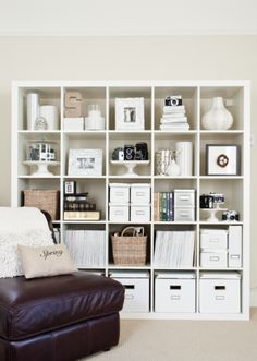 LOVE the vintage cameras on a cake pedestal....and how this Ikea bookcase looks in general? For the hallway?