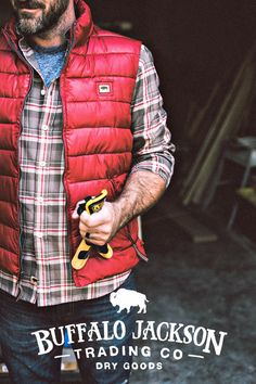 This mens vest has a rich texture from the light wax coating. (Shown here in brick red.) A quality micro puff mens vest, perfect for layering with an oxford or flannel shirt, jeans and boots. Also available in gray, rusty orange, or copper.