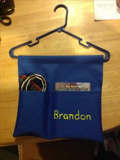 Hanging organizer holds Cub Scout book, neckerchief, slide, and belt. Just hang shirt over and keep it all together.