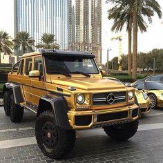 Custom gold Mercedes G-wag 6 wheeler Black Mercedes Benz, Mercedes G Wagon, Mercedes G Class, Mercedes Benz G Class, Gold Mercedes, Millionaire Lifestyle, 6x6 Truck, Trucks, Luxury Boat