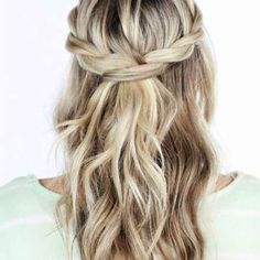 A pretty spin on the classic half-up half-down bridal hairstyle, this 'do is versatile and easy to c... - TwistMePretty