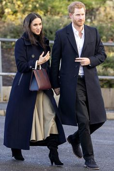 Wearing a Mackage coat and carrying a Strathberry bag.