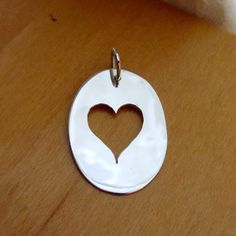 Heart Charm, Sterling Silver Cutout Pendant, Handmade in Maine by HarvestGoldJewelry on Etsy https://www.etsy.com/listing/77248691/heart-charm-sterling-silver-cutout