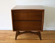 Mid century modern side end table nightstand with sculpted base and concave design