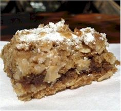 """These date bars were very popular in the 1950's and 1960's.  They only take a few minutes to assemble and 20 minutes to bake.  The crumbly topping is a combination of oats, flour and brown sugar."" Quote is from GourmetSleuth.com"