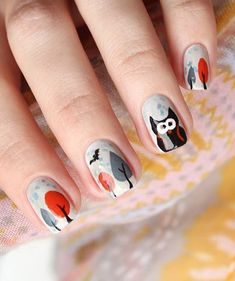 Cute gray nail - This is a very cute and candid gray nail art. Painted are fall colored tress as well as a big cute owl and flying birds.