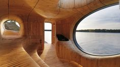 """Perched at the northwest edge of a private island in Ontario, the Grotto Sauna is a sculpted space designed by Partisans. """"Challenging the standards of current practices in the construction industry, we worked directly with a millwork and steel fabrication partner on every detail,"""" says the firm. """"Together, we developed a new process of fabrication; utilizing state of the art 3-D technology to scan, model and build the Grotto."""""""