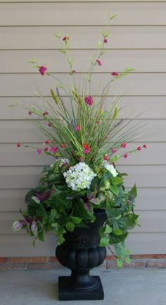 Container Garden with hydrangea, ivy, wandering jew, some type of grass and maybe carnations?