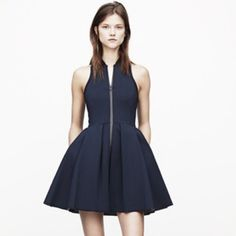T by Alexander Wang Pleated Scuba Dress S New T by Alexander Wang Pleated Neoprene Scuba Dress  Size: Small S  Color: Navy  Athletic attitude in its finest form, this short neoprene silhouette has an exposed front zipper, racerback and pleated A-line skirt.   Mandarin collar  Sleeveless  Front zipper  Pleated skirt  Racerback  Polyester/cotton/spandex T by Alexander Wang Dresses