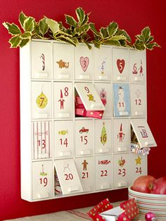 Advent calender cabinet...interesting idea. Bigger to store, but ample treat/gift space and would be fun to paint.