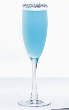 Dazzler - 2 oz. Hpnotiq, 2 oz. champagne - Pour chilled Hpnotiq and champagne into a flute and stir.