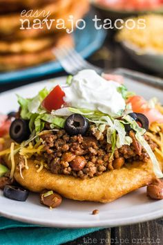 Easy Navajo Tacos by The Recipe Critic. School is now in session and I love creating easy and delicious meals!  It gets pretty hectic after the boys get home from school.  And I can't believe how much homework they get now.  My fourth grader spends about an hour an a half, and my kindergartener even gets some too!  These navajo tacos were simple to put together and the entire family loved them!