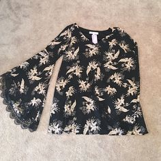 """NWT lace and floral mini dress Black mini with cream flowers and bell sleeves. Gorgeous lace detail on the sleeves. Comes about 2"""" above the knee but I am 5'8 with long legs. Honey Belle Dresses Mini"""