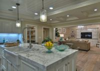Details a Design Firm, Spinnaker Development, Orange County, monochromatic, neutral, Zen inspired, coastal living, beach house, cottage, hanging lights, marble counter tops, under cabinet lighting, finished carpentry, white cabinets, recessed lighting