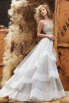 Hayley Paige. Moonstone tulle bridal ball gown with alabaster and crystal sweetheart strapless bodice, tiered tulle skirt with wide horsehair trim and chapel train.