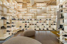 Kengo Kuma adds timber grid to Milan Camper store