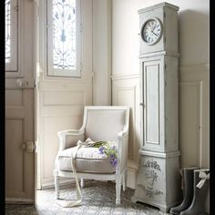 pretty entryway with pale blue tall skinny grandfather clock and shabby chic french chair