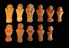 Prehistoric clay female and male figurines (left and right) from Utah's famous Pilling collection.