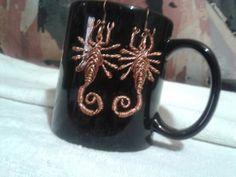 Aros de escorpiones. Hecho de alambre de cobre.