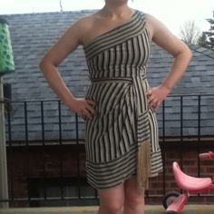 BCBG Max Azria dress Black striped and tan dress with fringe! In excellent condition! Worn only once! Pictures do not do it justice! BCBGMaxAzria Dresses