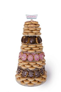 """Krispy Kreme addicts, rejoice! The company offer wedding doughnut stacks that are sure to make your guests say """"I dough"""". (Sorry.) (source)"""