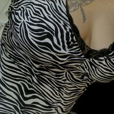 White House Black Market Top Sexy zebra print top with black lace trim from White House Black Market! In perfect condition!  Size medium. Measures 15.5 inches across from armpit to armpit and 15 inches in length from armpit. 97% polyester and 3% spandex. Wear as a sexy summer top or under a cropped jacket or sweater! White House Black Market Tops Tank Tops