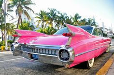 Pink 1959 Cadillac Series 62 Coupe parked on Collins Avenue in South Beach,