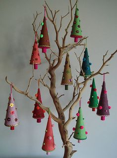This was used for a craft sale display, but the idea would be cute for a regular Christmas tree.  Bare tree branches with tiny decorated trees!  Love this.