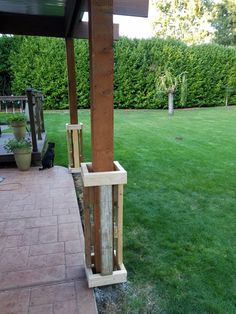 The panels were attached to a wooden framework built around the supporting patio posts. Front Porch Posts, Front Porch Columns, Front Porch Design, Porch Pillars, Deck Posts, Porch Post Wraps, Porch Column Wraps, Pergola, Gazebo