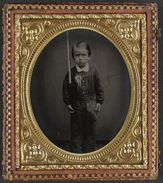 The Library of Congress [Unidentified young boy wearing secession badge and holding a rifle] (LOC)  [between 1861 and 1865]