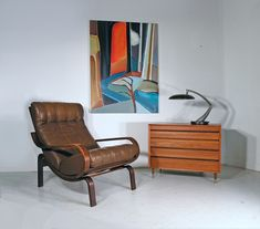 Westnofa mid century leather lounge chair, with Danish teak chest and painting by Lindsey Hambleton.  www.midcenturyhome.co.uk