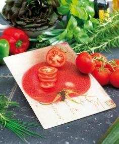 Tempered Glass Chopping Board This chopping board with a tomato design puts the fun back into vegetable chopping. The board is made of glass with a slightly roughened surface for optimum grip and anti-slip feet on the underside. Dishwasher-safe. Size 20 x 30 cm.