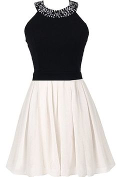First Kiss Dress: Features a beautiful rhinestone-embellished neckline, bold black top with pretty fitted waist, adorable bow decorating the backside, and a white skater-style skirt to finish.