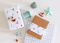 Dress up your gifts with holiday-themed wrapping paper.