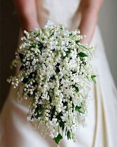 Cascading bouquet of lily of the valley and jasmine.