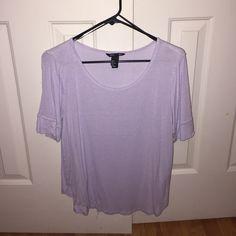 Purple H&M tee Loose fitting, size medium. Normal wear. Lavender color H&M Tops Tees - Short Sleeve