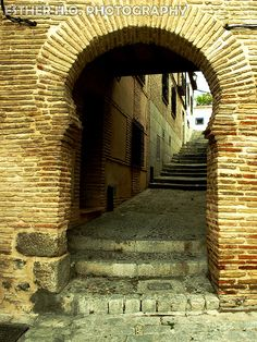 Toledo, Spain. I totally stood on those stairs and took this picture looking toward the archway.