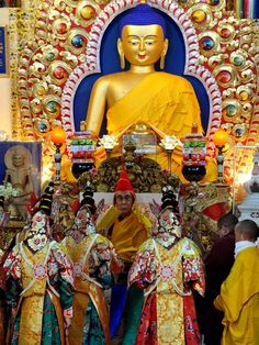 Tibetans dressed in religious attire pay obeisance to their spiritual leader, the Dalai Lama, during a prayer meeting at the Namgyal Monastry in Dharamshala.