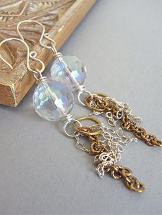 The Luna earrings - rock crystal quartz, brass and sterling combine in this design. $23. (only two pairs available.)