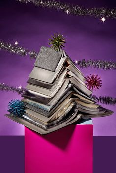It's Not Too Late To Have A Small-Space Christmas Tree #refinery29  http://www.refinery29.com/small-christmas-trees#slide2  The Tome Tree  The best tree is the one you already have. Take a trip down middle school memory lane and create glittery book covers with wrapping paper — to spruce up books you already own. Affix a few baubles with sticky gum for extra sparkle factor.