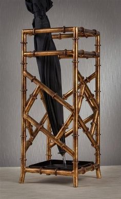 """Bamboo Umbrella Stand in Antique Gold by Dessau Home. $225.00. Made from iron. 8 in. L x 8 in. W x 21 in. H Value has always been an essential ingredient at Dessau Home. """"Essentials"""" represents a collection of well-appointed yet affordable home furnishings with a unique traditional styling that appeals to most transitional and contemporary home decorating needs.. Square shape. Square shape. Made from iron. 8 in. L x 8 in. W x 21 in. H Value has always been an essential ingre..."""