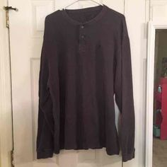 Men's Izod Henley Size XL. Dark grey. Worn a couple of times. A little wear and tear on the inside of the buttons area. Sorry, I don't trade. IZOD Tops Tees - Long Sleeve