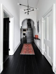 black wood floors, white walls and ceiling Black Floorboards, Black Wood Floors, Painted Wood Floors, Dark Flooring, Black Painted Walls, Hallway Flooring, Flooring Ideas, Laminate Flooring, Black Floor Paint