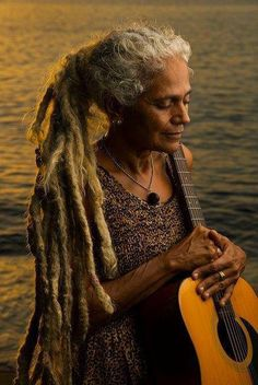 mmmm... a far away vision... when I am 70... may I look this serene, beautiful and have my guitar and music and wisdom to continue to share my medicine ....