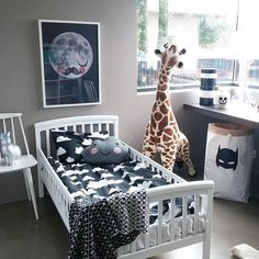 Boy's room. Silver rabbit lamp, life-size toy giraffe, cloud bedding and pillow, paper bag storage. www.petit.is