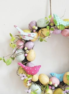 easter decoration ideas outdoor front door wreath colored eggs cloth birds