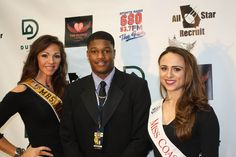 The #DuffyRealty #stepandrepeat at the National Signing Day at the Chic-fil-A College Hall of Fame with 2014 Mrs.Universe, Sabrina Pinion