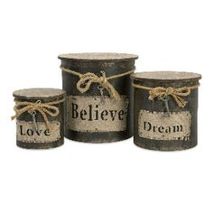 Make it myself... old popcorn tins from the thrift store. Paint, distress, modge podge lables, twine bows...