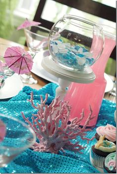 sparkly blue table runner for under the sea party. Also, coral from the fish dept. at walmart. Seaweed on wall!! Maybe a different princess theme on each table